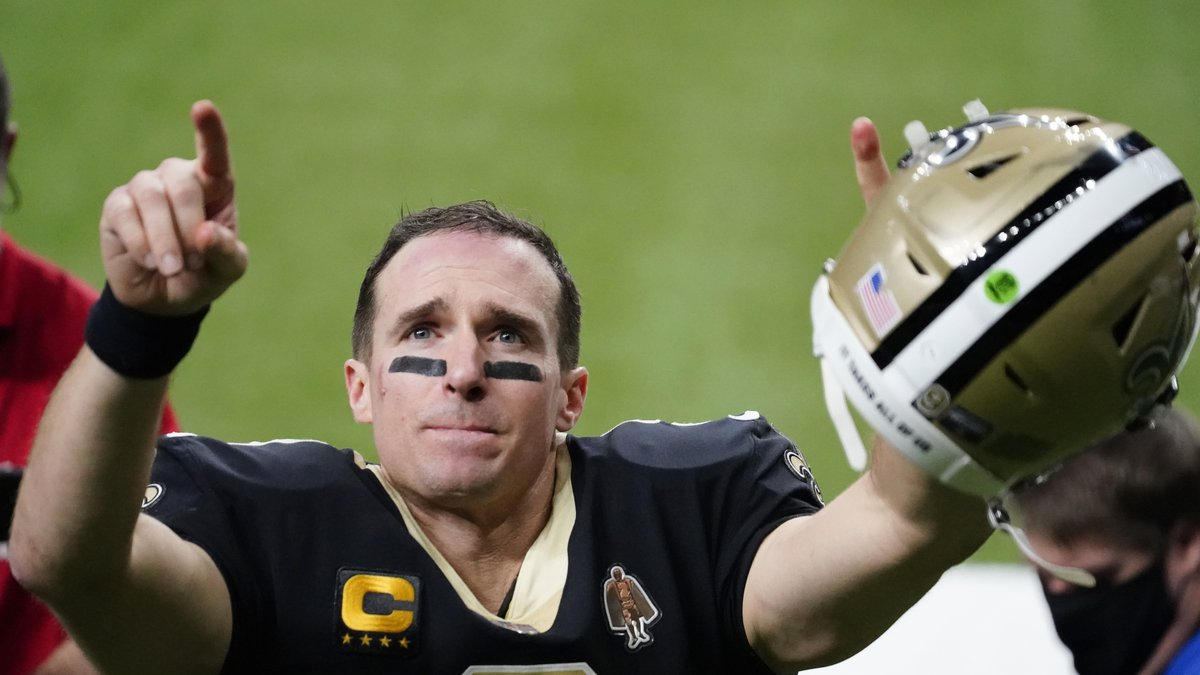 New Orleans Saints quarterback Drew Brees gestures to his family and fans after an NFL...