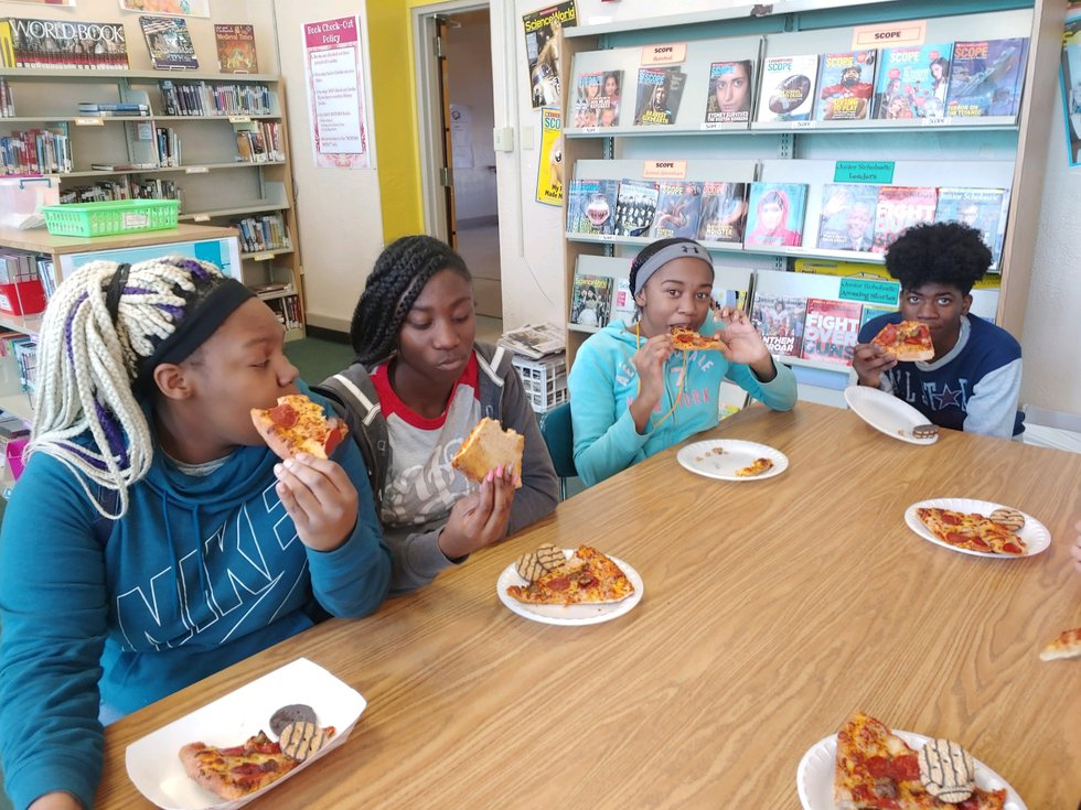 Students at Port Allen Middle enjoying pizza