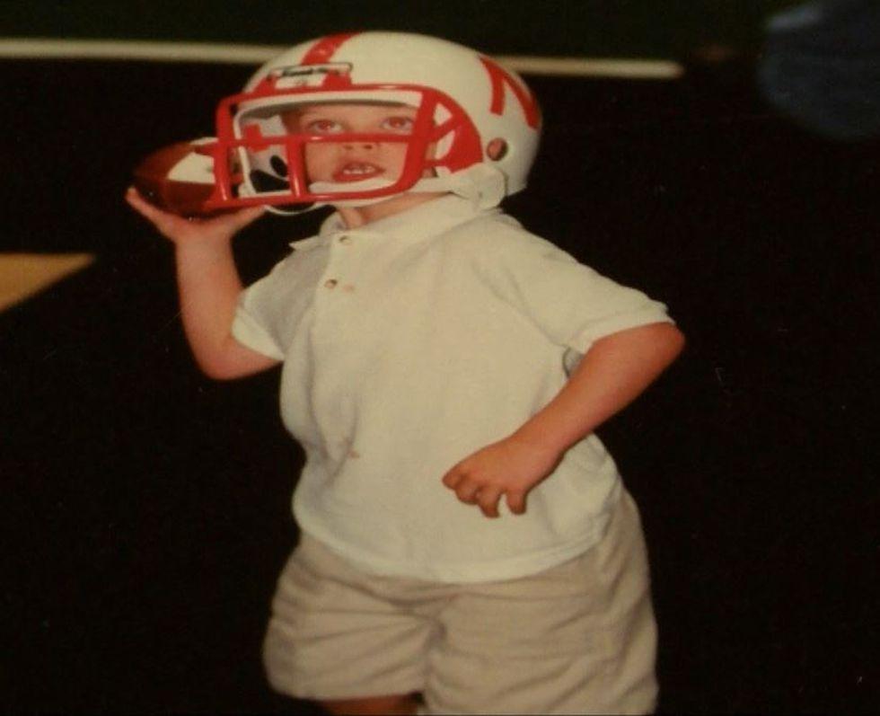 Joe Burrow as a child in a Nebraska helmet, where his father Jimmy Burrow  once coached.