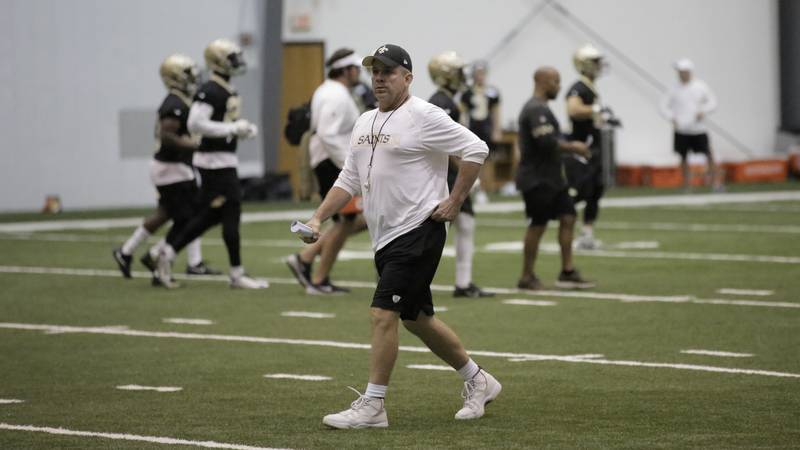 Saints head coach Sean Payton walks around one of his team's practices in the indoor facility