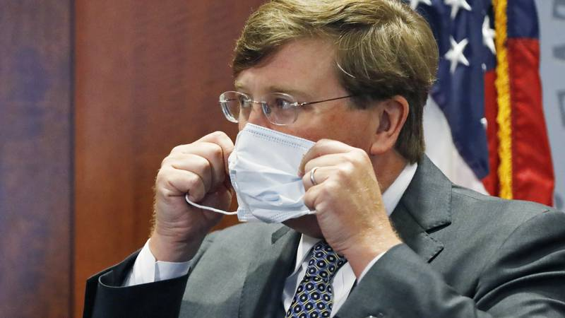 Gov. Tate Reeves adjusts his face mask as he prepares to leave his COVID-19 press briefing,...