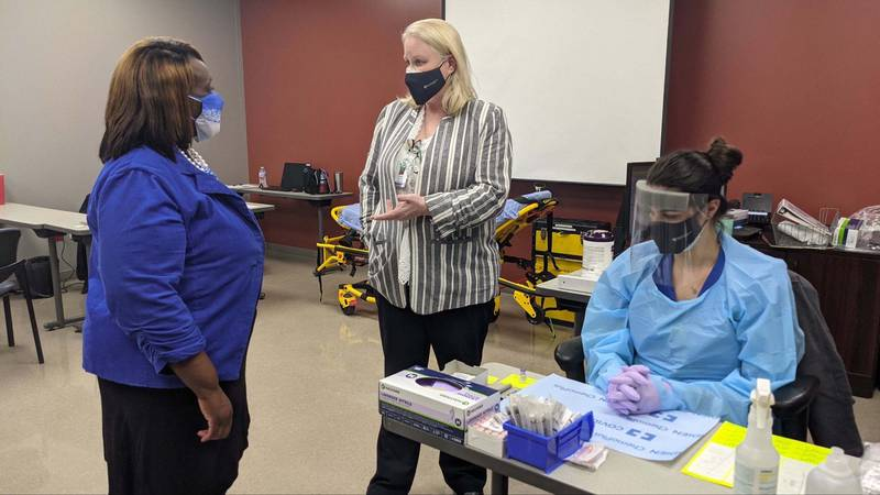Louisiana State Sen. Regina Barrow helps eligible patients get the COVID-19 vaccine at the Our...