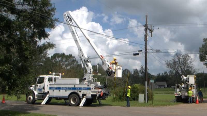 Utility crews repair power lines in Livingston Parish on Wednesday, Sept. 1, 2021.