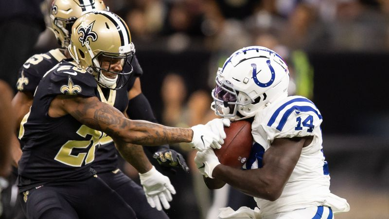 Saints cornerback P.J. Williams swipes at the football during game action against the...