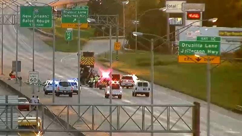 One person is dead after a truck overturned during a crash on I-12 West in Baton Rouge on...