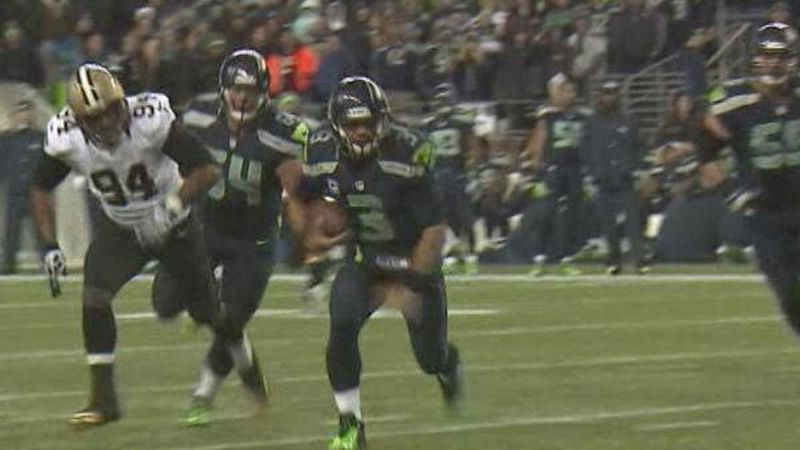 DE Cameron Jordan chases QB Russell Wilson in first game. Wilson ran for 15 yards on this play.