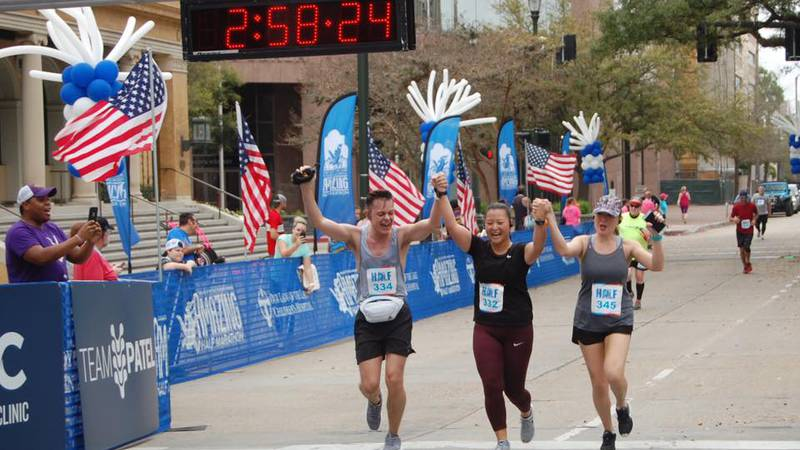 WAFB's morning news team (L-R: Dylan Collins, Liz Koh, Lauren Westbrook) crossing the finish...