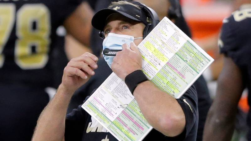 Saints head coach Sean Payton peers up in the midst of coaching during a game in the Superdome