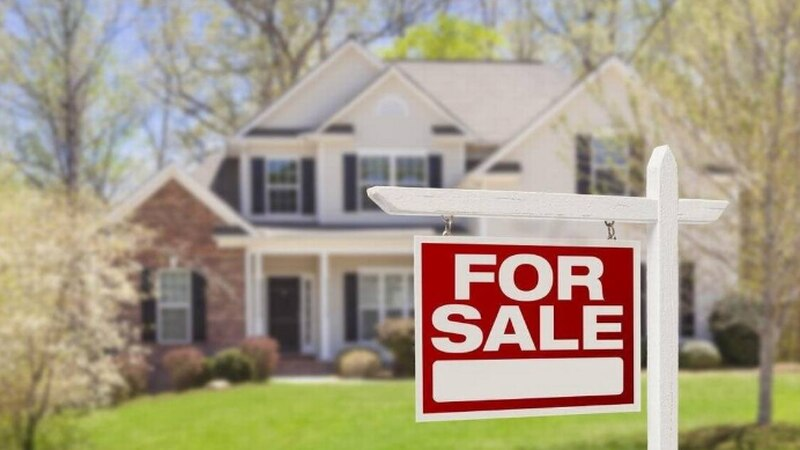 A house for sale. In Charlotte, home prices are shooting up as the number of houses on the...