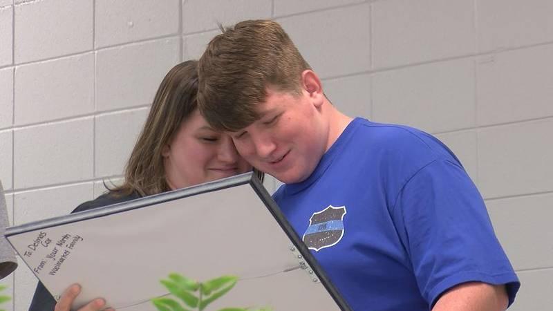 North Woolmarket Elementary & Middle School staff presented eighth-grader Delmas Cox a memorial...