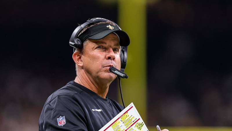 Saints head coach Sean Payton glances up from his playsheet during a home game in the Superdome