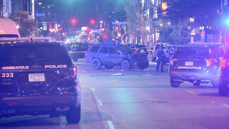 A vehicle shows damage early Monday morning after a protester was struck and killed in Uptown.