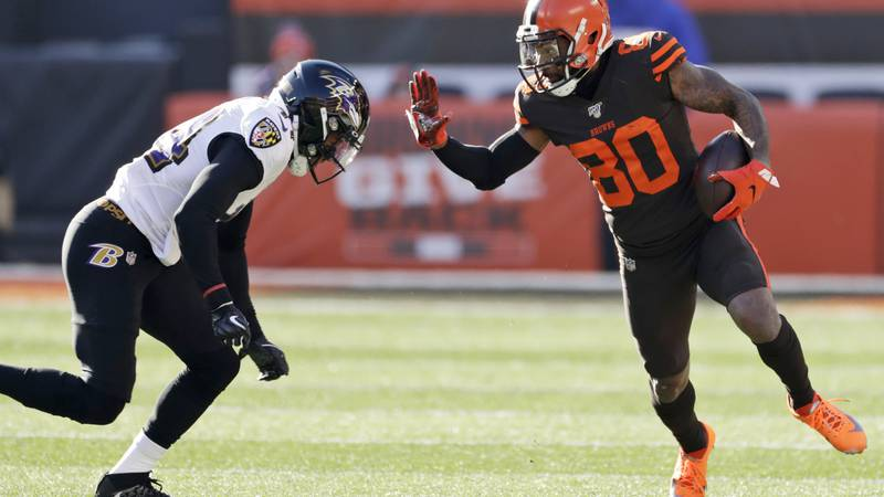 Cleveland Browns wide receiver Jarvis Landry (80) puts his arm out to block Baltimore Ravens...