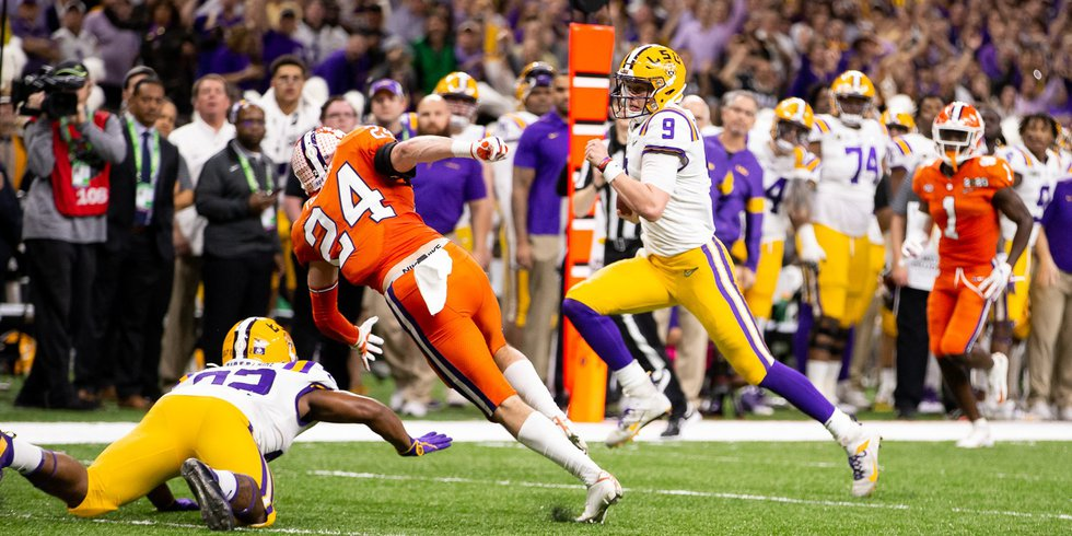 LSU quarterback Joe Burrow runs for a first down with :21 left in the first half against...