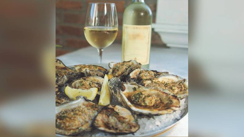 The restaurant is known for its char-grilled oysters and eclectic atmosphere.