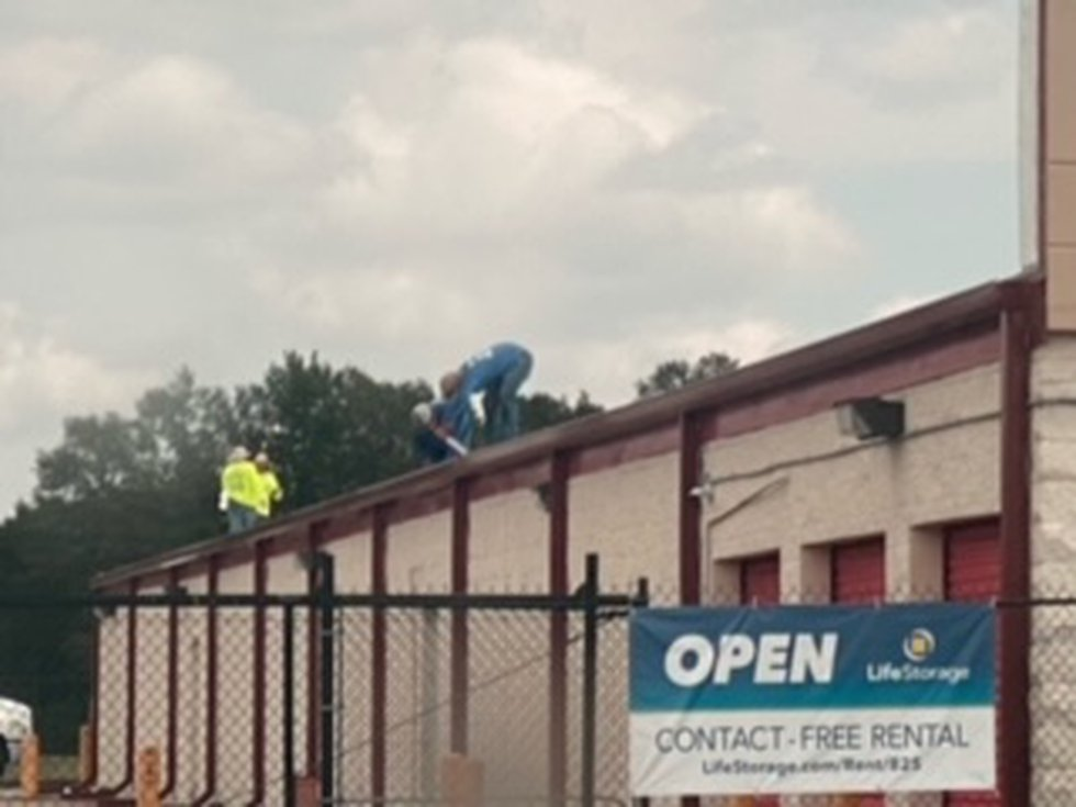 Overland captured images of crews doing roof repairs within 24 hours of WAFB's inquiries.