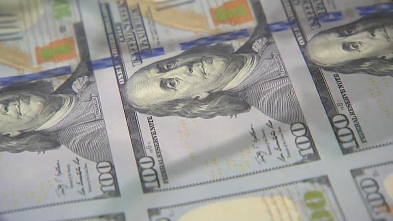 Photo of $100 bills.