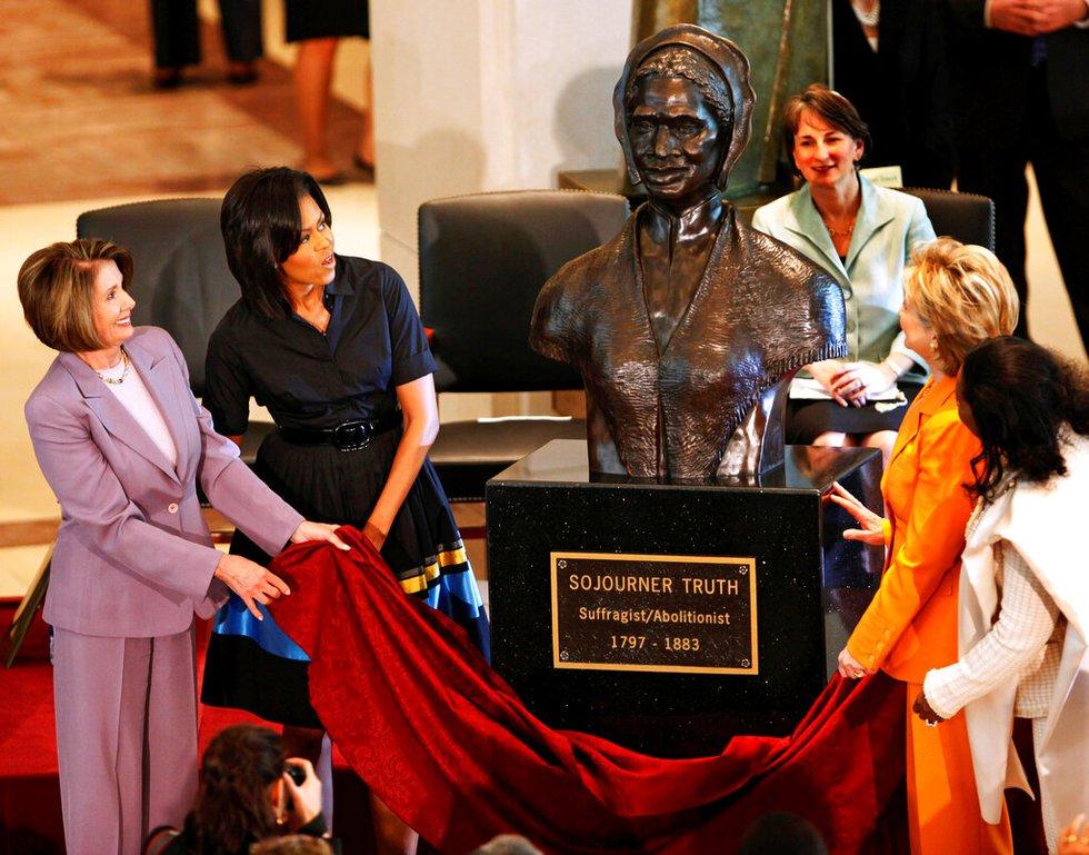 First lady Michelle Obama, second left, joins House Speaker Nancy Pelosi, left, Secretary of...