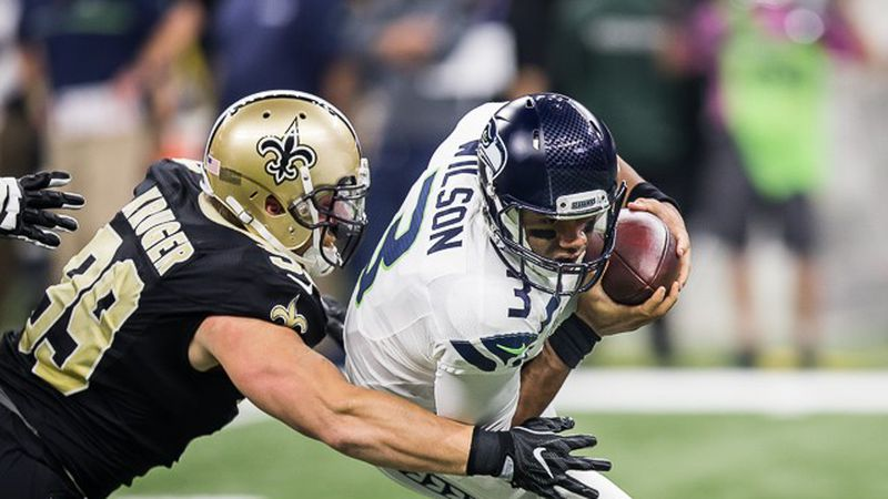 Russell Wilson fights for extra yards against the Saints in a 2016 matchup (Source: Mark...