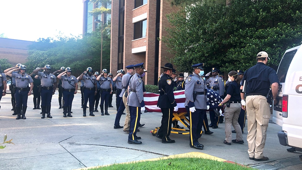 Comrades stood watch as the fallen Baton Rouge Police Department officer left Our Lady of the...