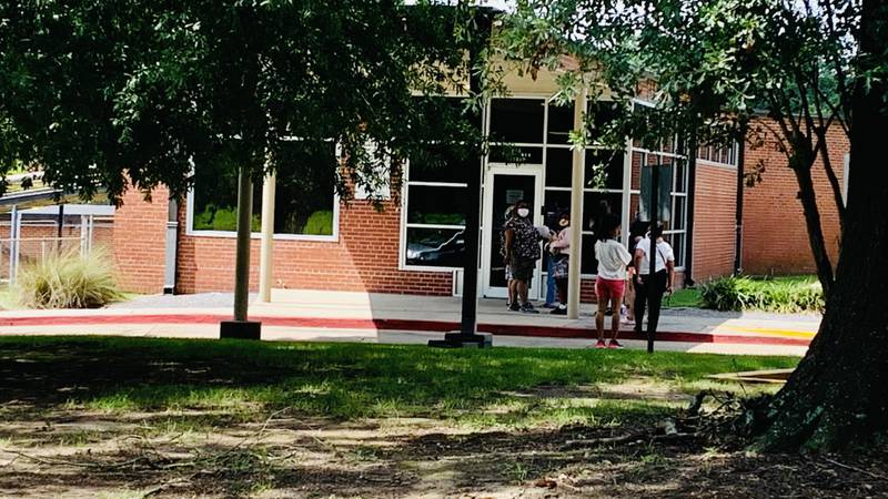 Long line of parents crowd outside of the East Baton Rouge school board office on Mayflower...
