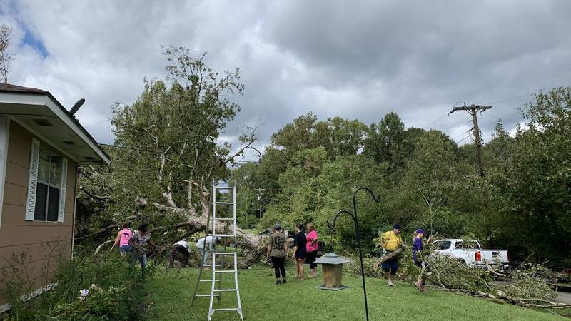 The neighborhood came together to help out with damage caused by Hurricane Delta.
