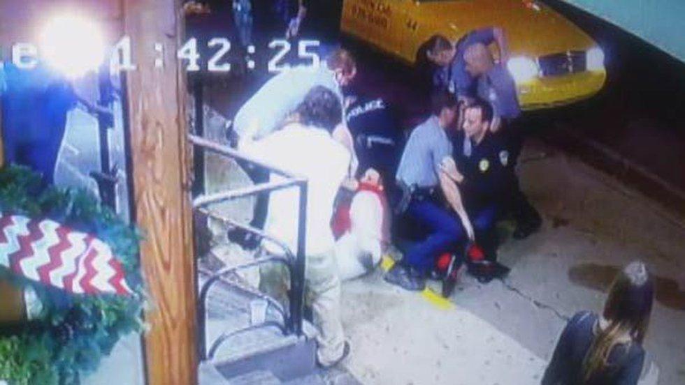 Officers arrest Daniel Clement. (Source: Varsity Theater Surveillance Video)