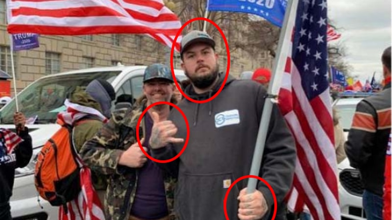 Cody Connell posing for a photo at the Capitol riots with his cousin, Daniel Adams.