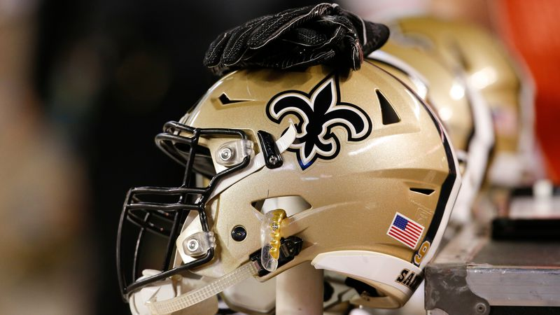A New Orleans Saints helmet sits on the bench during the first half of an NFL preseason...