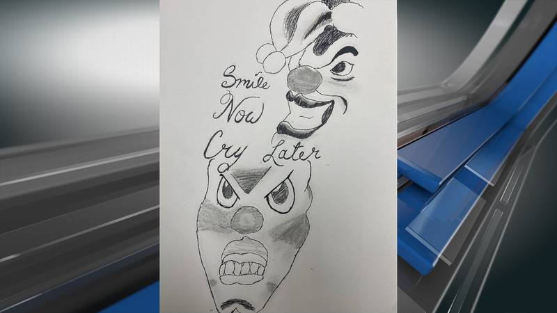 The body of an unknown female that has a tattoo of two jester masks with a script that reads,...