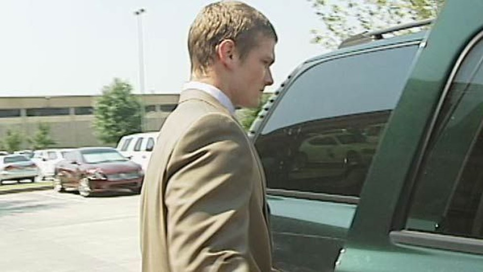 Josh Johns steps into an SUV following the meeting with BRPD.