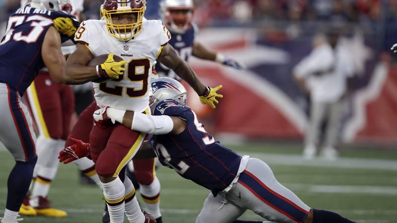 New England Patriots linebacker Elandon Roberts (52) tackles Washington Redskins running back...