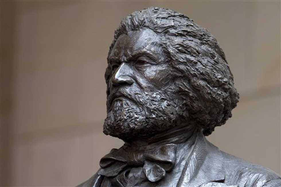 A bronze statue of 19th-century orator and writer Frederick Douglass is seen in the...