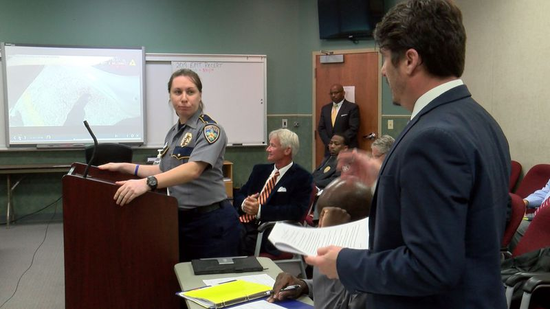 Officer Robin Ducote speaks before the Municipal Fire and Police Civil Service Board