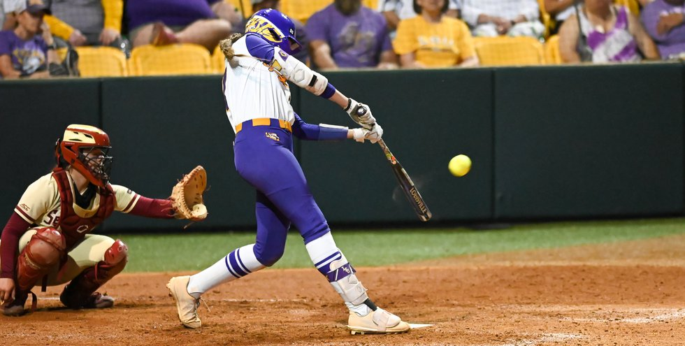 LSU shortstop Taylor Pleasants (17) hits a solo home run against Florida State in the NCAA...
