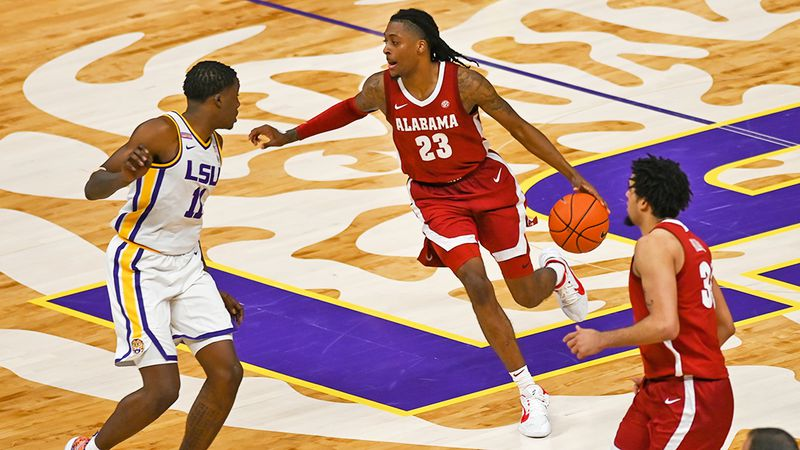 Alabama guard John Petty Jr. (23) dribbles against LSU in the Pete Maravich Assembly Center on...