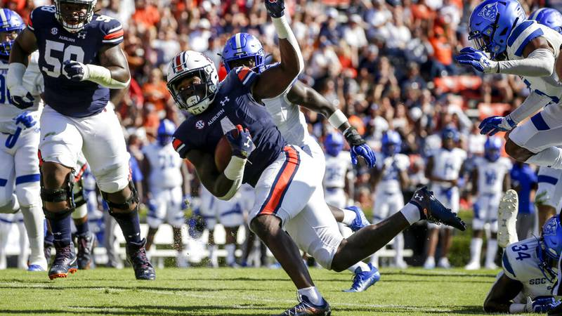 Auburn running back Tank Bigsby (4) carries the ball against Georgia State during the first...