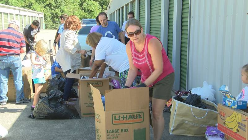 Community members packed supplies to send to Bahamas at a gathering organized by Jehu Poitier...