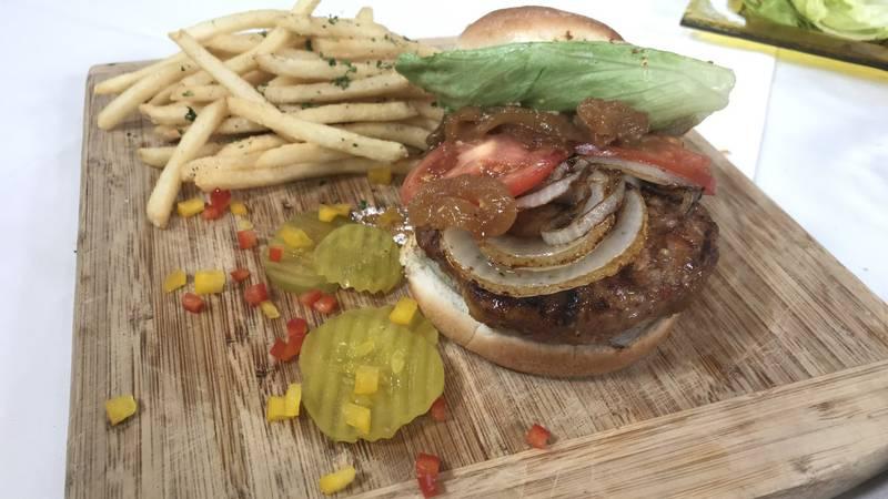 Pork, brats and shrimp burger with caramelized onion relish