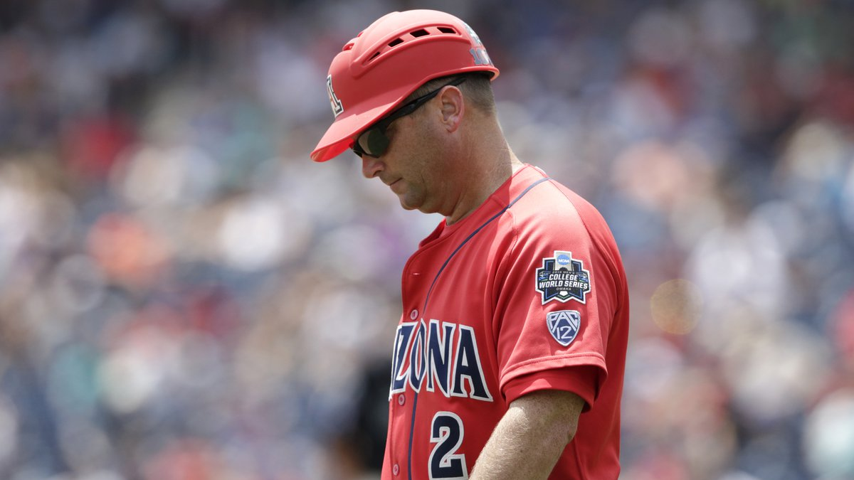 Arizona head coach Jay Johnson stands by third base in the sixth inning in Game 3 of the NCAA...