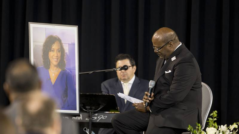 Glynn Boyd, Nancy's beloved husband, sings during his eulogy at her memorial service.