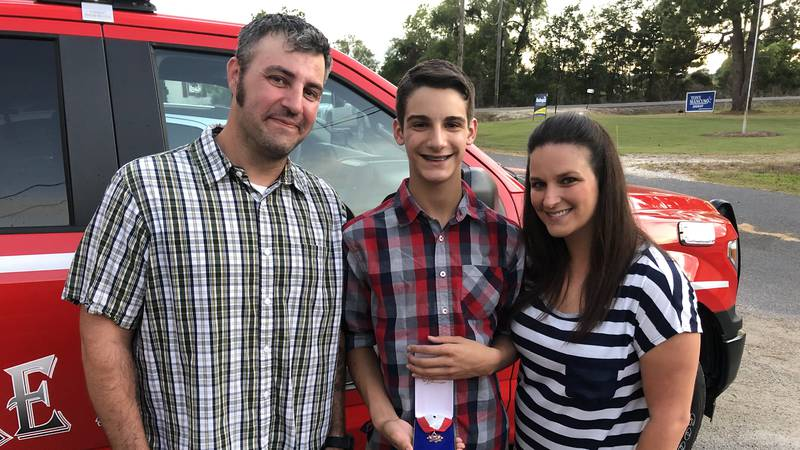 Local first responders honored 15-year-old Blaine Campbell for performing CPR on his father on...