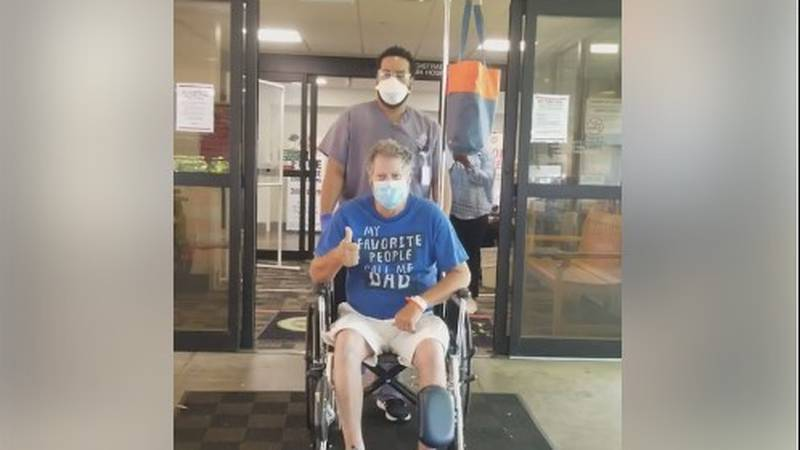 Joey Collum is wheeled out of Mississippi hospital after surviving COVID-19.