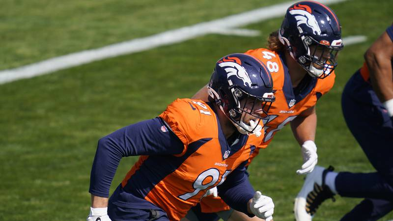 Denver Broncos linebackers Anthony Chickillo, front, and Derrek Tuszka take part in drills...