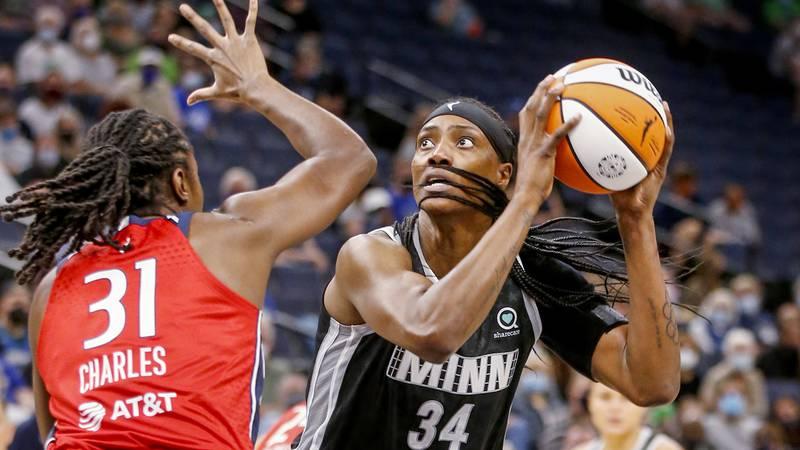 Minnesota Lynx center Sylvia Fowles (34) shoots over Washington Mystics center Tina Charles...