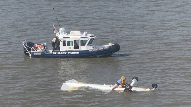 A Coast Guard helicopter crew, along with a St. Mary's Parish Sheriff's Office boat crew...