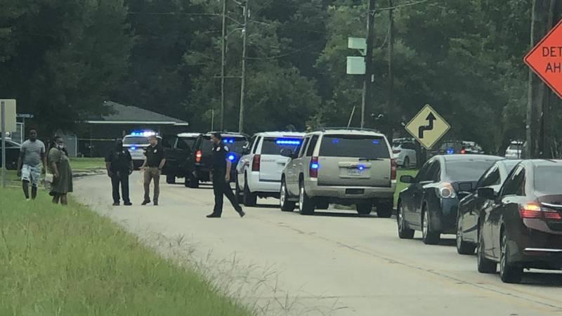 Armed man shot in Baker.