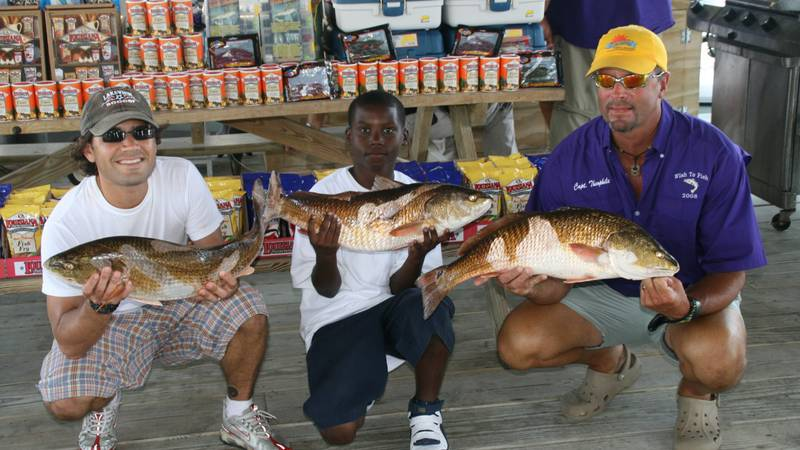 Theophile Bourgeois (far right) after a charity trip with the Wish to Fish organization. (Photo...