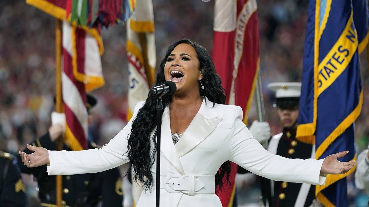 Demi Lovato performs the national anthem before the NFL Super Bowl 54 football game between the...