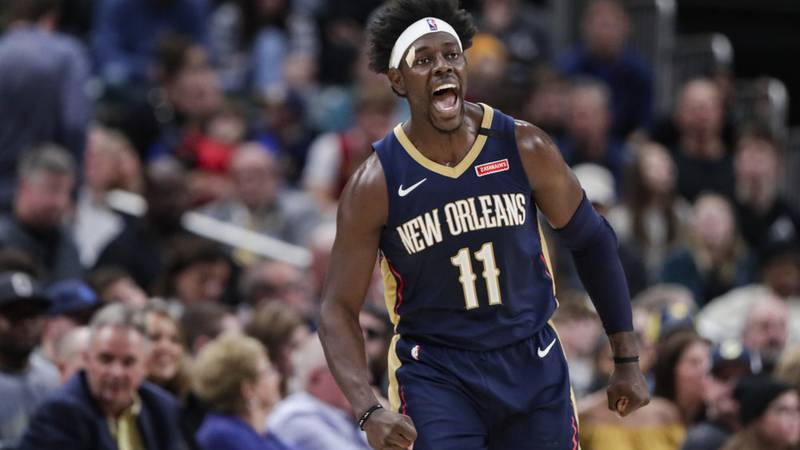 New Orleans Pelicans guard Jrue Holiday celebrates a 3-point basket late in the second half of...